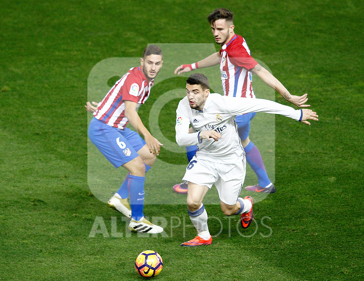 Atletico de Madrid's Koke Resurrecccion (l) and Saul Niguez (r) and Real Madrid's Mateo Kovacic during La Liga match. November 19,2016. (ALTERPHOTOS/Acero)