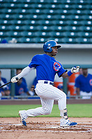 AZL Cubs second baseman Yonathan Perlaza (15) follows through on his swing against the AZL Rangers on July 24, 2017 at Sloan Park in Mesa, Arizona. AZL Cubs defeated the AZL Rangers 2-1. (Zachary Lucy/Four Seam Images)