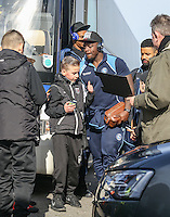 A young Grimsby supporter thanks Adebayo Akinfenwa of Wycombe Wanderers for the Photo as he arrives at the Sky Bet League 2 match between Grimsby Town and Wycombe Wanderers at Blundell Park, Cleethorpes, England on 4 March 2017. Photo by Andy Rowland / PRiME Media Images.