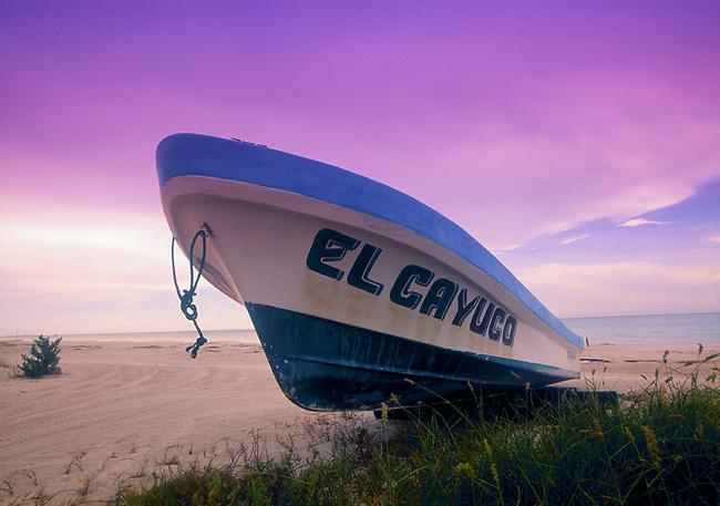 Fishing boat docked on the beach on Isla de Holbox, Mexico.