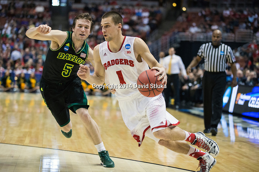 Wisconsin Badgers guard Ben Brust (1) drives past Baylor Bears guard Brady Heslip (5) during the fourth-round game in the NCAA college basketball tournament Thursday, March 27, 2014 in Anaheim, California. The Badgers won 69-52. (Photo by David Stluka)
