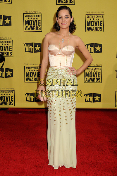 MARION COTILLARD.15th Annual Critics' Choice Movie Awards - Arrivals held at the Hollywood Palladium, Hollywood, California, USA, 15th January 2010..full length cream bustier skirt top strapless silk satin dress beige beaded gold long maxi hand on hip necklace clutch bag nude .CAP/ADM/BP.©Byron Purvis/Admedia/Capital Pictures