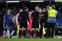 Chelsea Manager, Antonio Conte, speaks to the referee and his assistants at the final whistle during Chelsea vs Arsenal, Caraboa Cup Football at Stamford Bridge on 10th January 2018