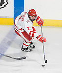 MADISON, WI - SEPTEMBER 29: Meghan Duggan #7 of the Wisconsin Badgers women's hockey team handles the puck against the Quinnipiac Bobcats at the Kohl Center on September 29, 2006 in Madison, Wisconsin. The Badgers beat the Bobcats 3-0. (Photo by David Stluka)