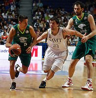 01.04.2012 SPAIN - ACB match played between Real Madrid vs Unicaja  at Palacio de los deportes stadium. The picture show Kristaps Valters (Unicaja) and  Sergio Llull Melia (Spanish point guard of Real Madrid)