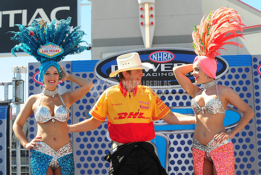 Apr. 13, 2008; Las Vegas, NV, USA: NHRA top fuel dragster driver David Grubnic jokes with showgirls prior to the SummitRacing.com Nationals at The Strip in Las Vegas. Mandatory Credit: Mark J. Rebilas-