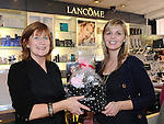 Letty Murtagh presents winner Sarah McCoy with her prize in the Lancome draw at McGoey pharmacy Ardee celebrating 12 years in business. Photo: Colin Bell/pressphotos.ie