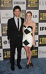 LOS ANGELES, CA. - March 05: Actors Adam Scott and Brittany Snow arrive at the 25th Film Independent Spirit Awards held at Nokia Theatre L.A. Live on March 5, 2010 in Los Angeles, California.