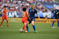 Cleveland, Ohio - Tuesday June 12, 2018: Ren Guixin, Samantha Mewis during an international friendly match between the women's national teams of the United States (USA) and China PR (CHN) at FirstEnergy Stadium.