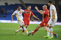 Cardiff City Stadium, Friday 11th Oct 2013. James Collins of Wales battles with Goran Pandev of Macedonia during the Wales v Macedonia FIFA World Cup 2014 Qualifier match at Cardiff City Stadium, Cardiff, Friday 11th Oct 2014. All images are the copyright of Jeff Thomas Photography-07837 386244-www.jaypics.photoshelter.com