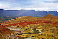 Rainbow spans over Painted Hills National Monument, central Oregon.