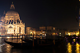 ITALY, Venice. A night view of the Basilica di Santa Maria della Salute and the Grand Canal.