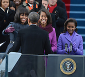 President Barack Obama greets his family after being sworn-in for a second term as the President of the United States by Supreme Court Chief Justice John Roberts during his public inauguration ceremony at the U.S. Capitol Building in Washington, D.C. on January 21, 2013.  The first family looks on.   .Credit: Pat Benic / Pool via CNP