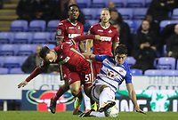 Roque Mesa of Swansea City is tackled by ,r,8, during the Carabao Cup Third Round match between Reading and Swansea City at Madejski Stadium, Reading, England, UK. Tuesday 19 September 2017