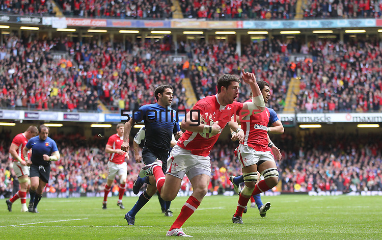 Alex Cuthbert celebrates on his way to scoring the first try of the match for Wales..RBS 6 Nations 2012.Wales v France.Millennium Stadium.17.03.12..CREDIT: STEVE POPE-SPORTINGWALES