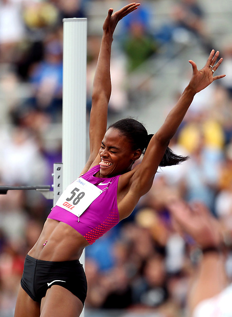 "Nike's Chaunte Lowe celebrates with the cheering capacity crowd after clearing 6' 5"" to win the women's high jump special April 24, 2010 at the Drake Relays in Des Moines."