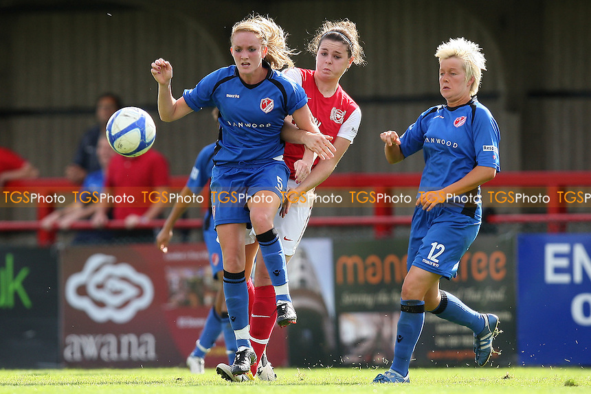 Sophie Bradley of Lincoln clashes with Jennifer Beattie of Arsenal - Arsenal Ladies vs Lincoln Ladies - FA Womens Super League Continental Tyres Cup Semi-Final at Boreham Wood FC - 11/09/11 - MANDATORY CREDIT: Gavin Ellis/TGSPHOTO - Self billing applies where appropriate - 0845 094 6026 - contact@tgsphoto.co.uk - NO UNPAID USE.
