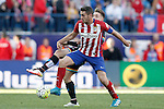 Atletico de Madrid's Koke Resurrecccion (f) and Rayo Vallecano's Aras Ozbiliz during La Liga match. April 30,2016. (ALTERPHOTOS/Acero)