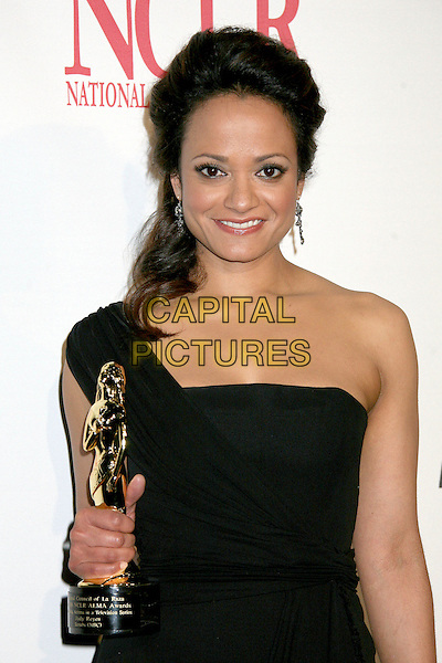 JUDY REYES.2006 NCLR ALMA Awards at the Shrine Auditorium - Pressroom, Los Angeles, California, USA..May 7th, 2006.Photo: Byron Purvis/AdMedia/Capital Pictures.Ref: BP/ADM.half length black one shoulder award trophy.www.capitalpictures.com.sales@capitalpictures.com.© Capital Pictures.