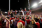 Wisconsin Badger fans celebrate their victory over the Ohio State Buckeyes after an NCAA college football game on October 16, 2010 at Camp Randall Stadium in Madison, Wisconsin. The Badgers beat the Buckeyes 31-18. (Photo by David Stluka)