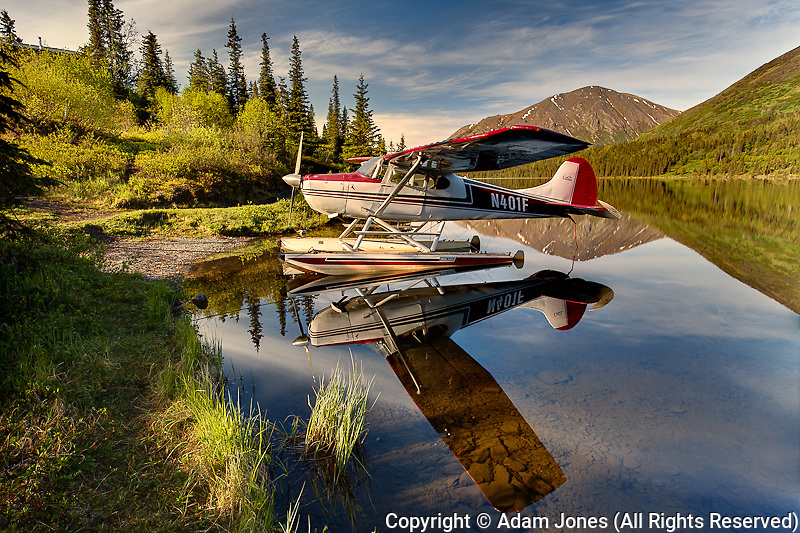 Float plane docked on small remote lake, Alaska