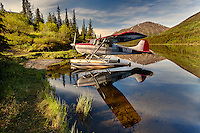 Float plane docked on small remote lake, Alaska
