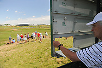 A manual score keeper loads the sign board near the 11th green during Thursday's round 1 of the 117th U.S. Open, at Erin Hills, Erin, Wisconsin. 6/15/2017.<br /> Picture: Golffile | Ken Murray<br /> <br /> <br /> All photo usage must carry mandatory copyright credit (&copy; Golffile | Ken Murray)