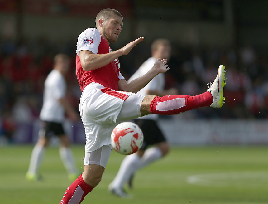 Fleetwood Town's Jamie Proctor blocks a clearance from Colchester United's goalkeeper Elliott Parish<br /> <br /> Photographer Stephen White/CameraSport<br /> <br /> Football - The Football League Sky Bet League One - Fleetwood Town v Colchester United - Saturday 22nd August 2015 - Highbury Stadium - Fleetwood<br /> <br /> &copy; CameraSport - 43 Linden Ave. Countesthorpe. Leicester. England. LE8 5PG - Tel: +44 (0) 116 277 4147 - admin@camerasport.com - www.camerasport.com
