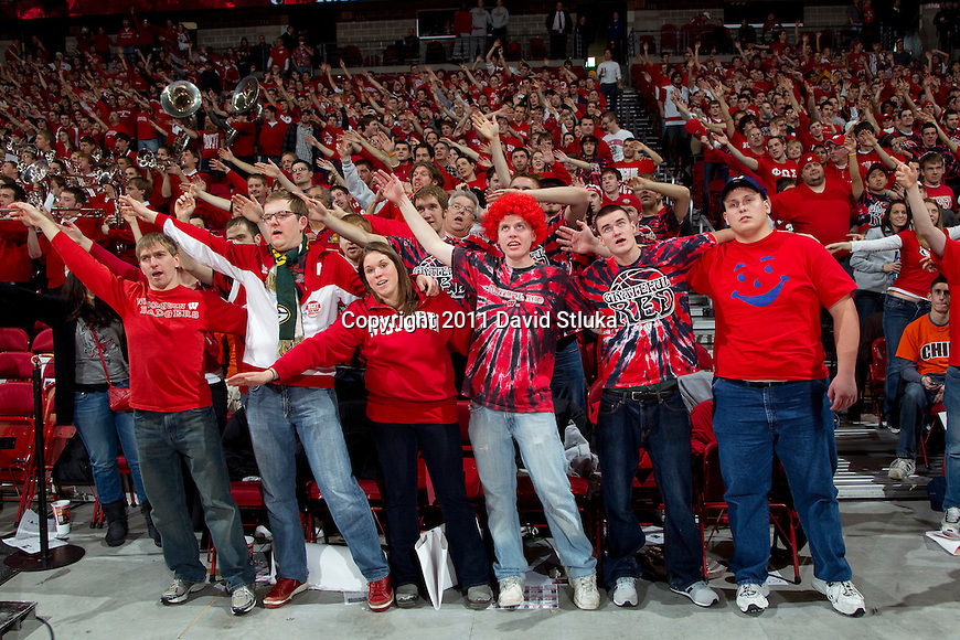 Wisconsin Badgers fans sing Varsity during a Big Ten Conference NCAA college basketball game against the Illinois Fighting Illini at the Kohl Center in Madison, Wisconsin on January 15, 2011. Wisconsin won 76-66. (Photo by David Stluka)