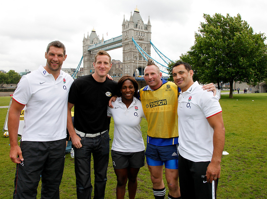 Photo: Richard Lane/Richard Lane Photography. O2 Touch Launch, an RFU initiative aiming to get England playing touch rugby at Potters Field, London. 17/06/2011. Rugby stars with an event participant.