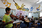 A Palestinian orphans play music in the SOS Children's Village in Rafah the southern Gaza Strip on June 6, 2010. The school for orphans that was established in 2000 with the sponsorship of the Austrian SOS international, faces the threat of closure because of the longstanding Israeli blockade on the Gaza Strip.. Photo by Hatem Omar