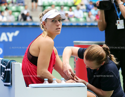 September 23, 2017, Tokyo, Japan - Angelique Kerber of Germany gets a medical treatment from a doctor during the semi final of the Toray Pan Pacific Open tennis championships in Tokyo on Saturday, September 23, 2017. Pavlyuchenkova defeated Kerber 6-0, 6-7 (7-4), 6-4.    (Photo by Yoshio Tsunoda/AFLO) LWX -ytd-