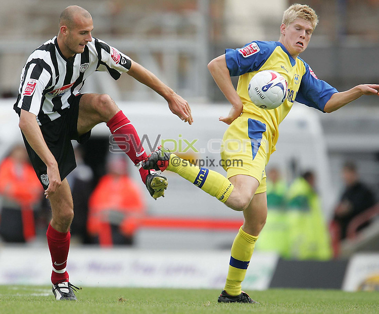 Pix by JOHN CLIFTON/SWpix.com -  Football, Coca Cola League 2, Grimsby Town v Torquay United, Blundell Park, Grimsby, 17/09/05..Picture Copyright >> Simon Wilkinson >> 07811267706..Grimsby's Robert Jones go for a ball in the middle of the pitchTorquay's Alan Connell