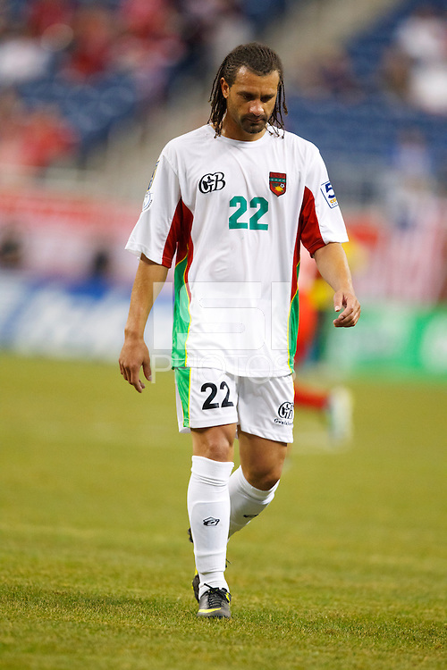 7 June 2011: Guadeloupe defender Mickael Tacalfred (22) walks off the pitch after recieving a red card during the CONCACAF soccer match between Panama and Guadeloupe at Ford Field Detroit, Michigan.