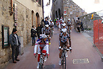 Riders make their way to sign on before the start of the Strade Bianche Eroica Pro 2015 cycle race 200km over the white gravel roads from San Gimignano to Siena, Tuscany, Italy. 8th March 2015<br /> Photo: Otto de Waele/www.newsfile.ie