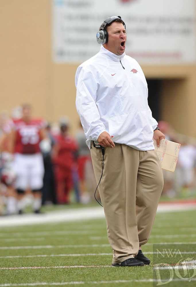 NWA Media/ANDY SHUPE - Arkansas coach Bret Bielema speaks to his team against Nicholls during the first quarter Saturday, Sept. 6, 2014, at Razorback Stadium in Fayetteville