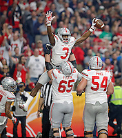 Ohio State Buckeyes wide receiver Michael Thomas (3) celebrates his touchdown catch with offensive lineman Pat Elflein (65) against Notre Dame Fighting Irish in the first quarter during the Fiesta Bowl in the University of Phoenix Stadium on January 1, 2016.  (Dispatch photo by Kyle Robertson)
