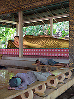 Just like this reclining Buddha statue, workers at this Monastery having a nap the same way at a Monastery on the outskirts of Phnom Penh. Cambodia Chin Puskak, Temple,
