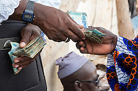 Cashew Nut Buyer Paying the Seller,  Fass Njaga Choi, The Gambia