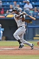 Charleston RiverDogs shortstop Jorge Mateo (2) swings at a pitch during a game against the Asheville Tourists on June 30, 2015 in Asheville, North Carolina. The RiverDogs defeated the Tourists 10-4. (Tony Farlow/Four Seam Images)