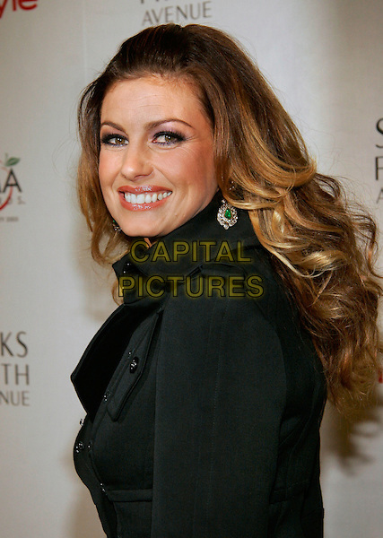 FAITH HILL.The Saks Fifth Avenue and Instyle Magazine CMA Reception.  New York..USA, United States..14th November 2005.Ref: ADM/JL.portrait headshot black large collar jacket top coat wavy tousled hair.www.capitalpictures.com.sales@capitalpictures.com.© Capital Pictures.