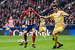 Victor Machin, Vitolo (L), of Atletico de Madrid competes for the ball with Francisco Aday Benitez of Girona FC during the La Liga 2017-18 match between Atletico de Madrid and Girona FC at Wanda Metropolitano on 20 January 2018 in Madrid, Spain. Photo by Diego Gonzalez / Power Sport Images