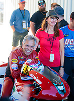 Oct 18, 2019; Ennis, TX, USA; NHRA pro stock motorcycle rider Hector Arana Sr and wife Grace Arana during qualifying for the Fall Nationals at the Texas Motorplex. Mandatory Credit: Mark J. Rebilas-USA TODAY Sports
