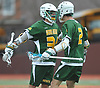 Dylan Pallonetti #34 of Ward Melville, left, gets congratulated by teammate Trey Berry #2 after scoring a goal in the second quarter of a non-league varsity boys lacrosse game against host Chaminade High School on Saturday, April 7, 2018. Ward Melville won by a score of 11-7.