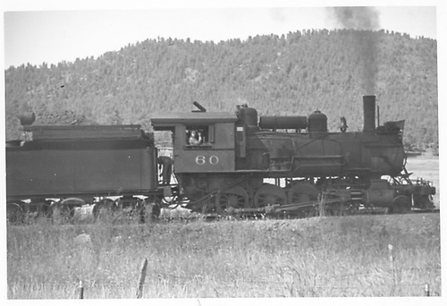 Engineer's-side view of MT #60 heading a freight.<br /> Midland Terminal