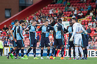 The Wycombe team come together for a pre match team huddle during the Sky Bet League 2 match between Leyton Orient and Wycombe Wanderers at the Matchroom Stadium, London, England on 19 September 2015. Photo by Andy Rowland.