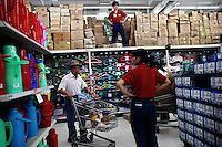 Workers restock the shelves at a Wal-Mart Superstore in Nanjing, China.