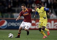 Calcio, Serie A: Roma vs Chievo Verona, Stadio Olimpico, Roma, 7 maggio  2013..AS Roma forward Francesco Totti, left, is challenged by ChievoVerona midfielder Isaac Cofie, of Ghana, during the Italian serie A football match between Roma and ChievoVerona at Rome's Olympic stadium, 7 maggio  2013..UPDATE IMAGES PRESS/Isabella Bonotto
