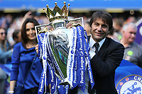Chelsea Manager, Antonio Conte, celebrates winning the Premier League as he holds onto the Trophy during Chelsea vs Sunderland AFC, Premier League Football at Stamford Bridge on 21st May 2017