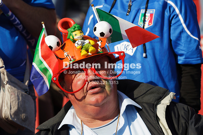 JOHANNESBURG, SOUTH AFRICA - JUNE 24:  A spectator wears a lekarapa colorfully decorated with flags and figures at the FIFA World Cup Group F match between Italy and Slovakia at Ellis Park Stadium on June 24, 2010 in Johannesburg, South Africa.  Editorial use only.  Commercial use prohibited.  No push to mobile device usage.  (Photograph by Jonathan Paul Larsen)